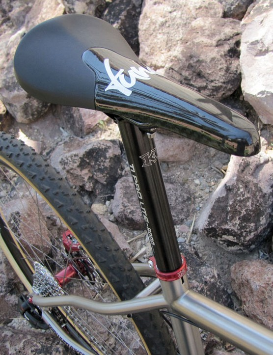 A Tune saddle is perched atop a KCNC aluminium post