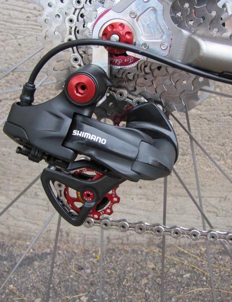 The rear derailleur gets the full KCNC treatment with red anodised aluminium pulleys and bolts