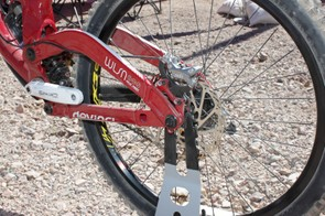 Wilson's geometry is adjustable via a Split Pivot axle mounted chip, hence the reason for two brake mounting positions