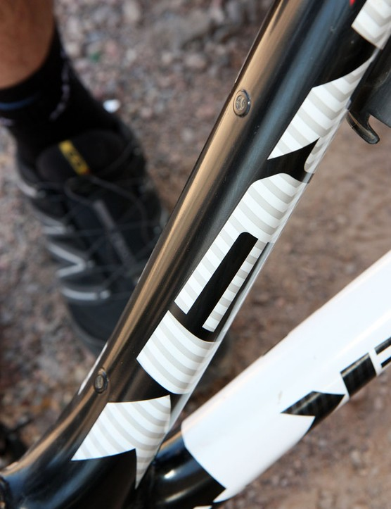 We weren't able to get a definitive answer on what these mounting holes were for on the underside of the down tube but a bolt-on mudguard (US: fender) seems likely for muddy races