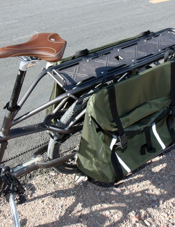The rear panniers are designed to haul two full-size paper grocery bags eac