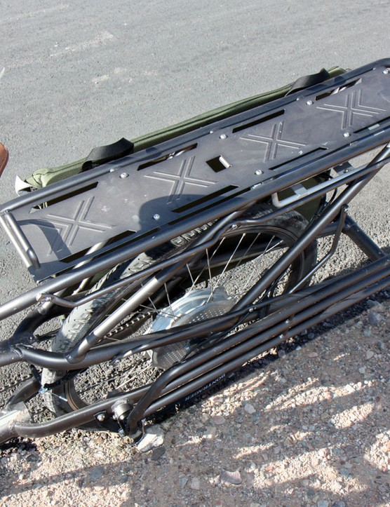 When not needed, the lower shelves of the rear rack fold up neatly against the frame