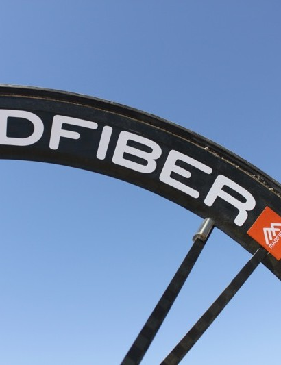 Madfiber uses a 60mm front rim; the included spoke magnet is pictured under the R