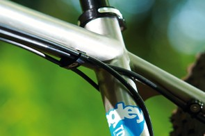 cables are kept neat and tidy,  showing off the appealing raw  titanium of the frame below