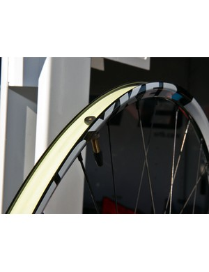 The alloy WTB Stryker rims use airtight rim tape to seal up the spoke holes