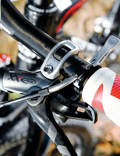 The fork's remote lockout lever sits neatly on the bar