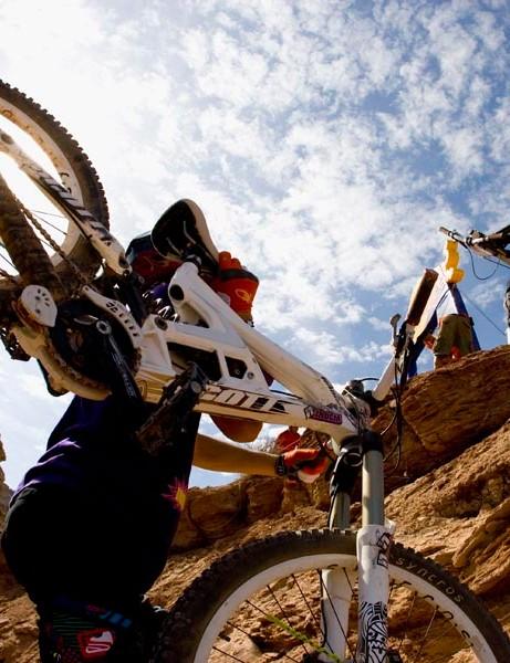 Garett Buehler and James Doerfling with their bikes on their backs