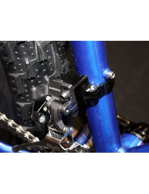 The custom clamp on the Salsa Mukluk snow bike is designed to work with the latest direct-mount front derailleurs