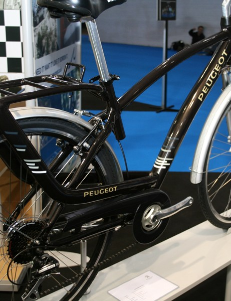 The Attitude 'trekking' bike has an aluminium frame, suspension fork and seatpost, and comes with a front hub dynamo