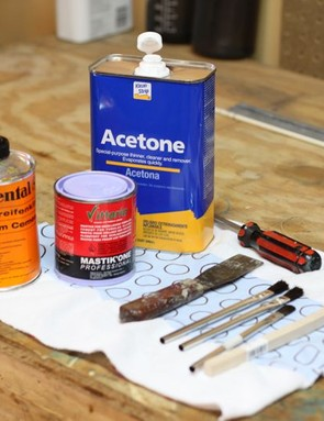 Supplies for tire prep and applying glue: acetone, glue, wire brush, putty knife, acid brushes
