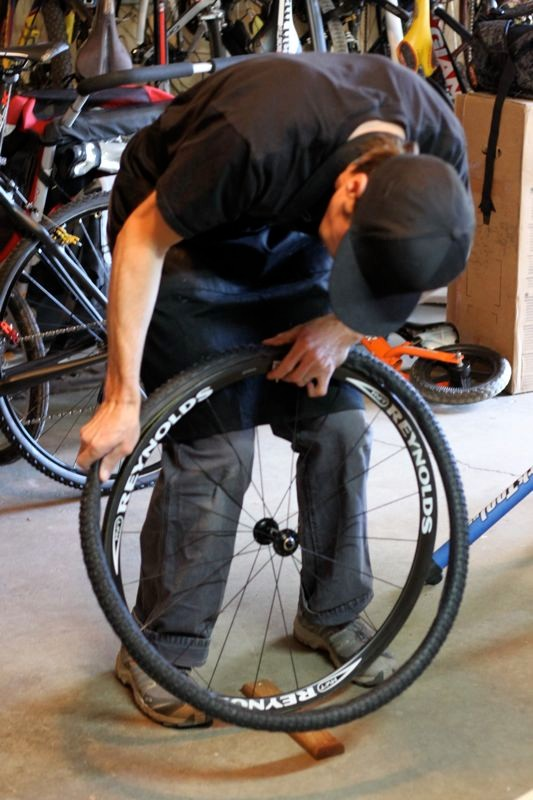 Once the last layer of glue is applied to the rim only, give it just a few minutes and mount the tire, starting with the valve stem at the top