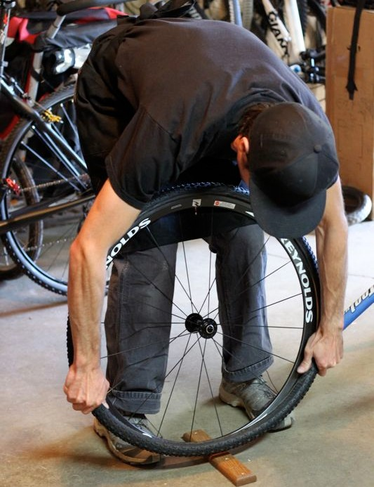 Stretch the tire down around the rim as firmly as possible