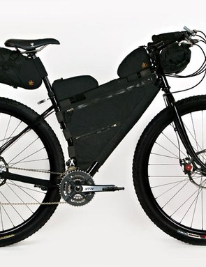 Jeff Jones steel Diamond frame and fork decked with touring bags