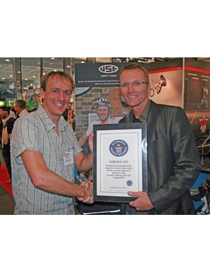 Vin Cox (left) is presented with his Guinness World Record certificate by Geoff Thomas