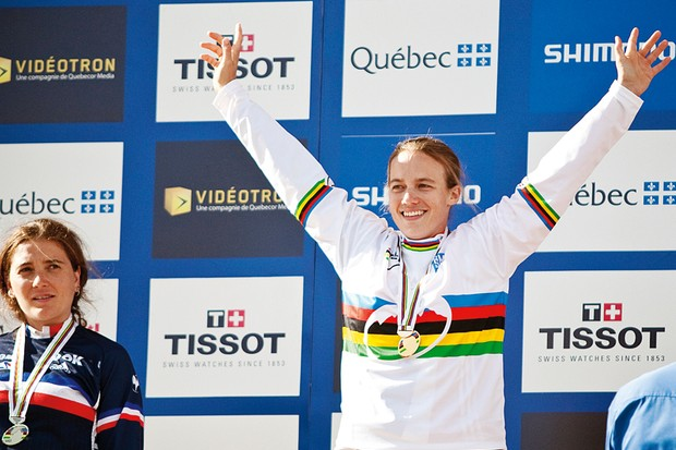 Tracy Moseley celebrates winning the women's 2010 Downhill World Championship while arch rival Sabrina Jonnier looks on
