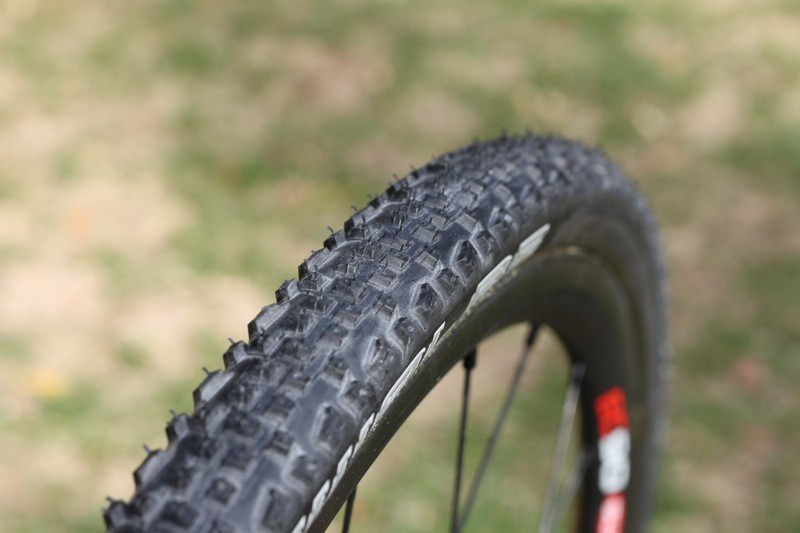 The Racing Ralph tread seems to be somewhere in between the intermediate and aggressive mud treads other manufacturers offer