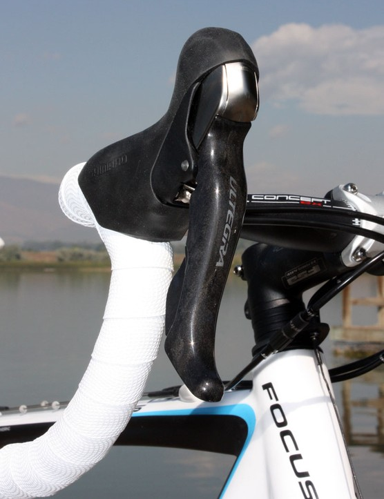 The carbon fiber blades of the Shimano Ultegra STI Dual Control levers are less punishing on your hands when it's cold out but the dangerously exposed shifter internals and annoying long lever throws make them less-than-ideal for 'cross racing