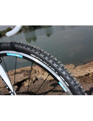 Tall, square, and openly spaced knobs on the Schwalbe Rocket Ron clinchers offer plenty of grip on sketchy ground but are a little slow on harder surfaces