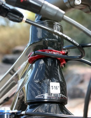 Orbea's clever Direct Cable Routing configuration feeds the housing into a head tube-mounted guide.  Bend radii are quite tight, though, especially with the narrow stock bar