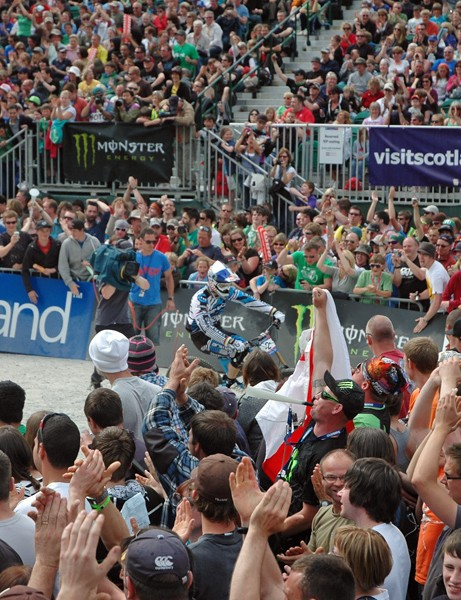 The huge crowd applauds Gee Atherton's winning run at Fort William