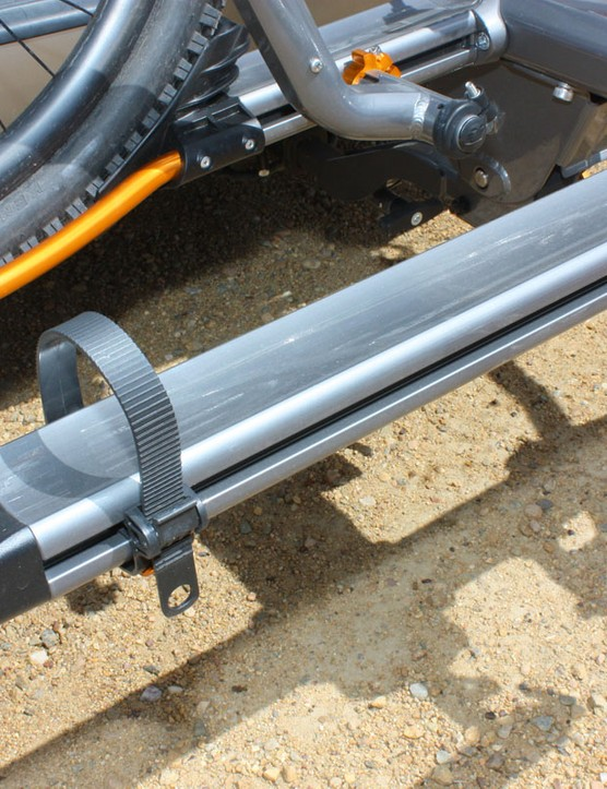 The simple ratcheting straps work well enough and have a wide range of adjustment