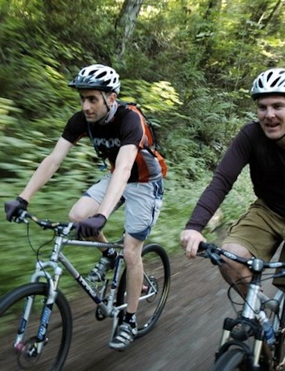 Chris DiStefano (left) riding with Tom Miller, the Chief of Staff for Mayor Sam Adams (right)