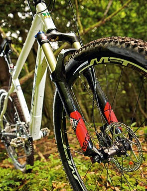 RockShox's Reba fork is a decent coil sprung mid-ranger, but lighter riders will need to consider switching springs