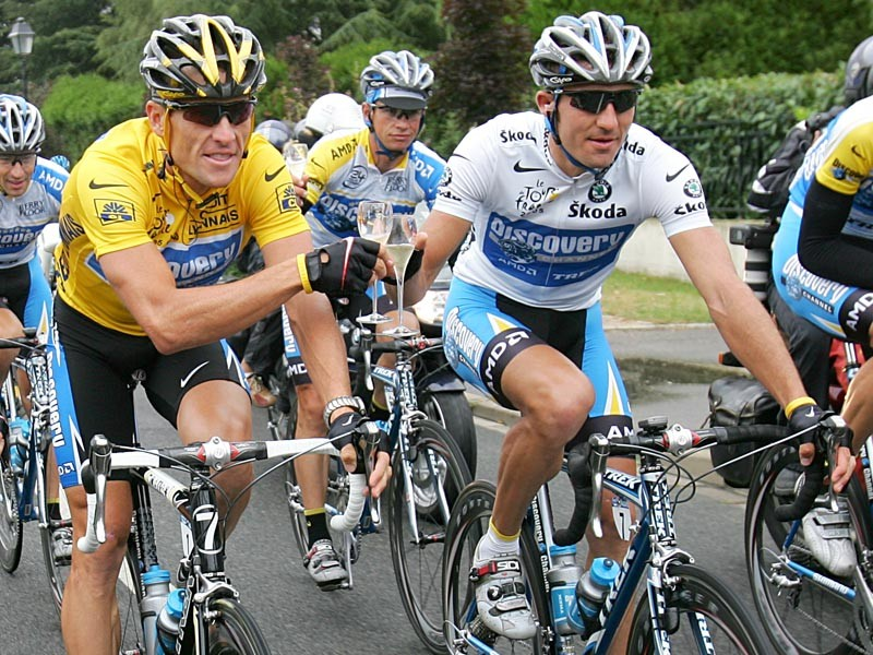 Lance Armstrong of the USA riding for the Discovery Channel team celebrates with teammate Yaroslav Popovych of Ukraine and the Discovery Channel team during Stage 21 of the Tour de France between Corbeille-Essones and The Champs Elysees on July 24, 2005 in Paris, France.