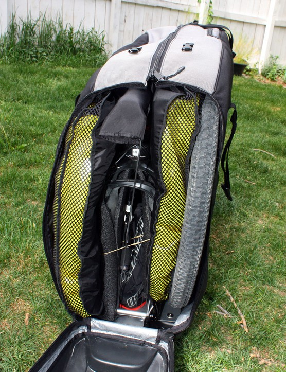 The five-layer design puts the wheels at the outermost edges then sandwiches the rest of your bike between two big inflatable pillows that not only add padding but help keep the contents from shifting around