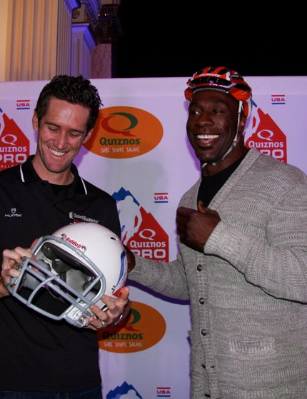 Sharpe and Rory Sutherland of United Healthcare trade helmets and autographs