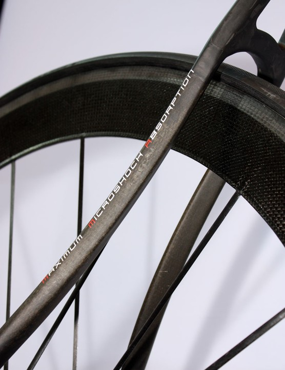 Flax fibers strategically placed throughout the frame supposedly absorb more road shock than carbon fibers alone