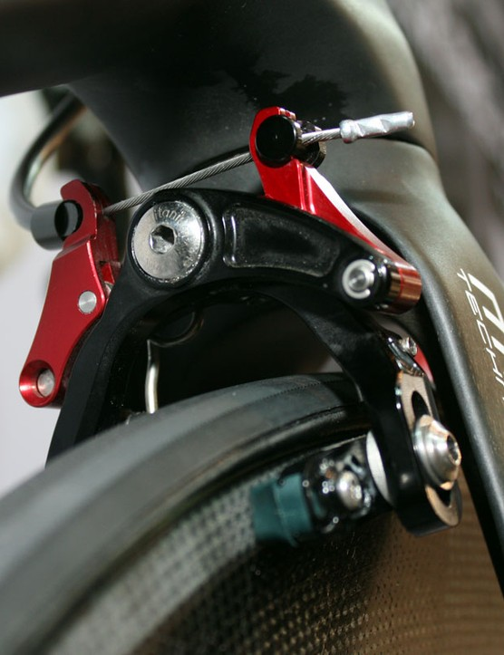 The front brake is positioned behind the fork crown