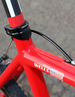 The tall seatpost collar presumably clamps extra-tightly on the carbon post. The rear brake cable exits through the removable access port for easier routing