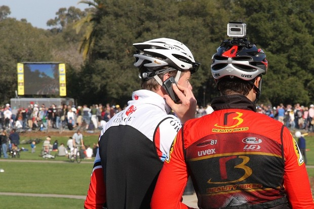 Helmet cams are still allowed in races, but we can't advise racing while on a cell phone