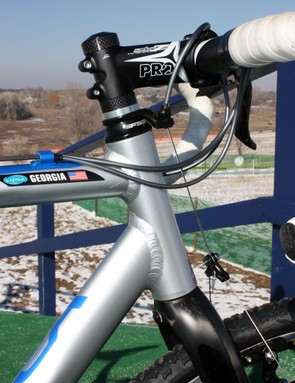 Georgia Gould's (Luna) Orbea Lobular Cross uses a straight 1-1/8in head tube and a separate front brake housing stop instead of FSA's 'cross-specific integrated setup