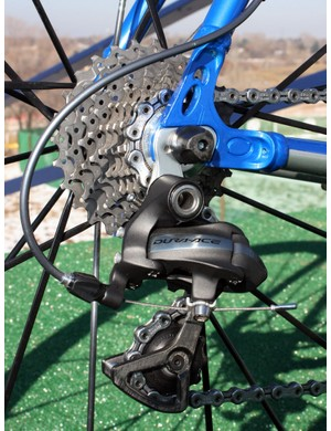 The Shimano Dura-Ace 7900 rear derailleur is bolted to a replaceable hanger