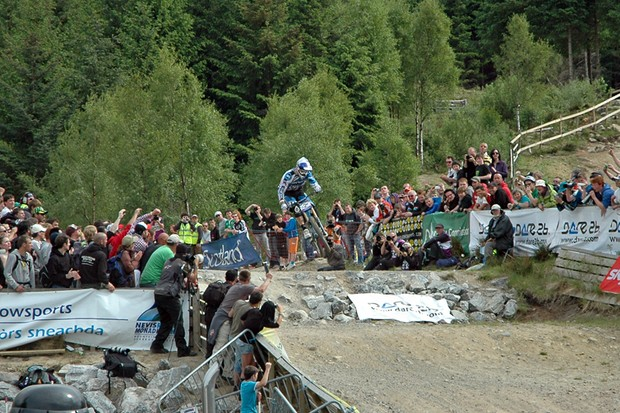 Gee Atherton drops into the finish arena at the 2010 Fort William World Cup