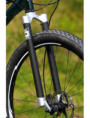 On-One's own carbon fibre rigid fork delivers accurate tracking and manages to take some sting out of the trail
