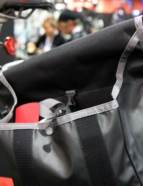 Timbuk2's so-called 'smiley face' opening on some of their bags naturally folds the inner portion of the bag inwards to help keep water from entering