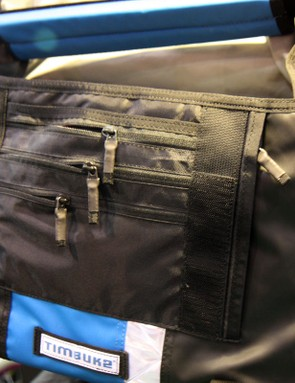 Organizer pockets beneath the main flap help keep smaller items from getting lost in the shuffle. Note the shrink-wrapped zipper pulls to keep things quiet