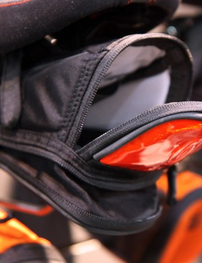 The flip-down opening helps keep items from falling out, a built-in clip keeps your keys handy, and an expandable bottom opens up when you've got a little more to carry than originally planned