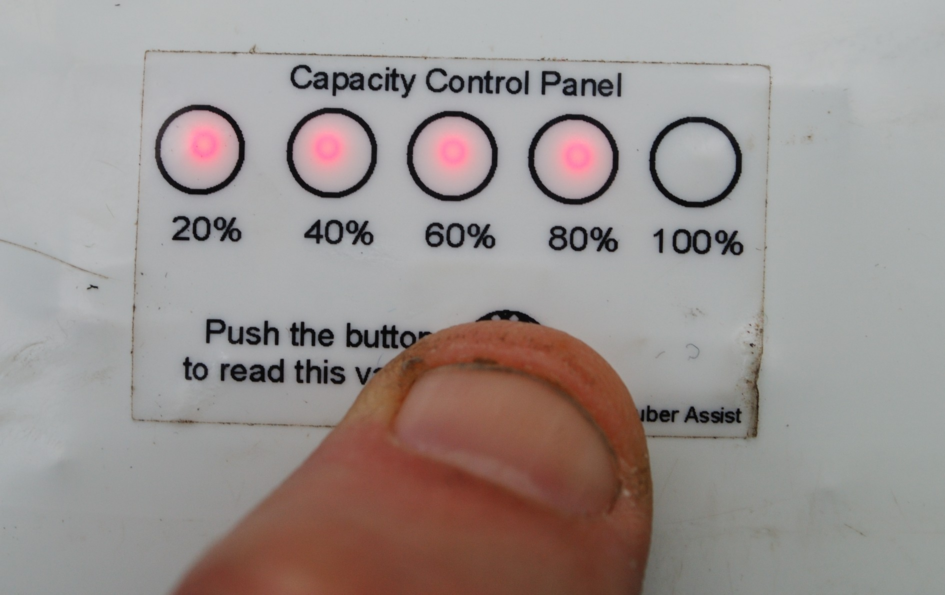You must remove the battery pack to get at the battery level indicator