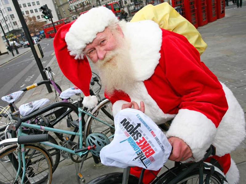 Santa has been out and about in London handing out saddle covers to promote The London Bike Show
