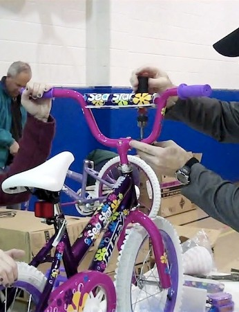 Volunteers from local bicycle groups, local companies and The Salvation Army joined Tender Ridge Angus beef and Spartan Stores to help assemble bicycles in Grand Rapids, Mich
