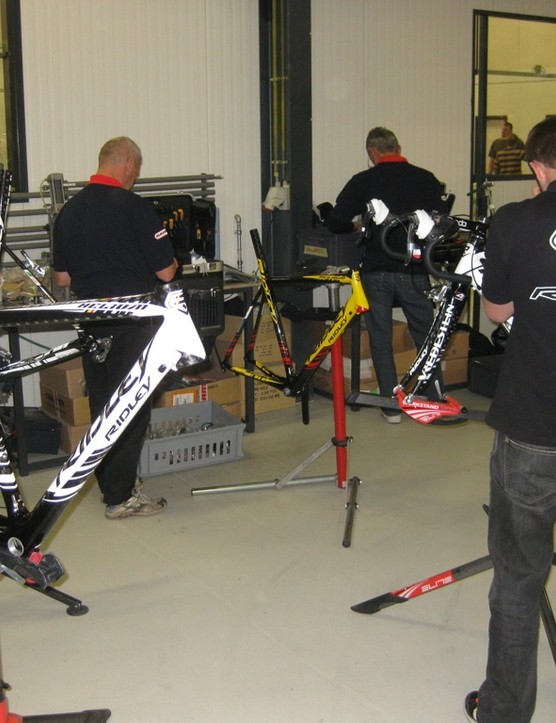 Team mechanics prep the new Vacansoleil race machines for the upcoming season