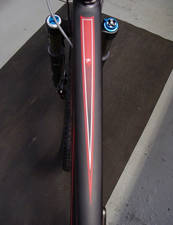 The top tube transitions to an integrated headset and what looks to be a tapered head tube