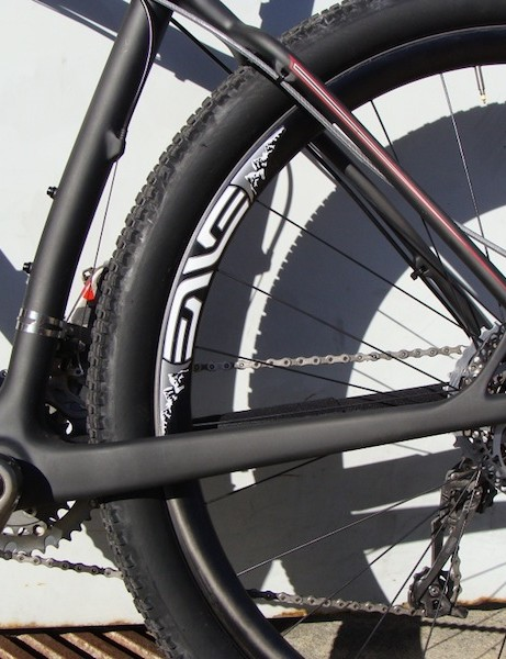 The new frame sports a sexy curved seat tube, which likely keeps the frame's chainstays short