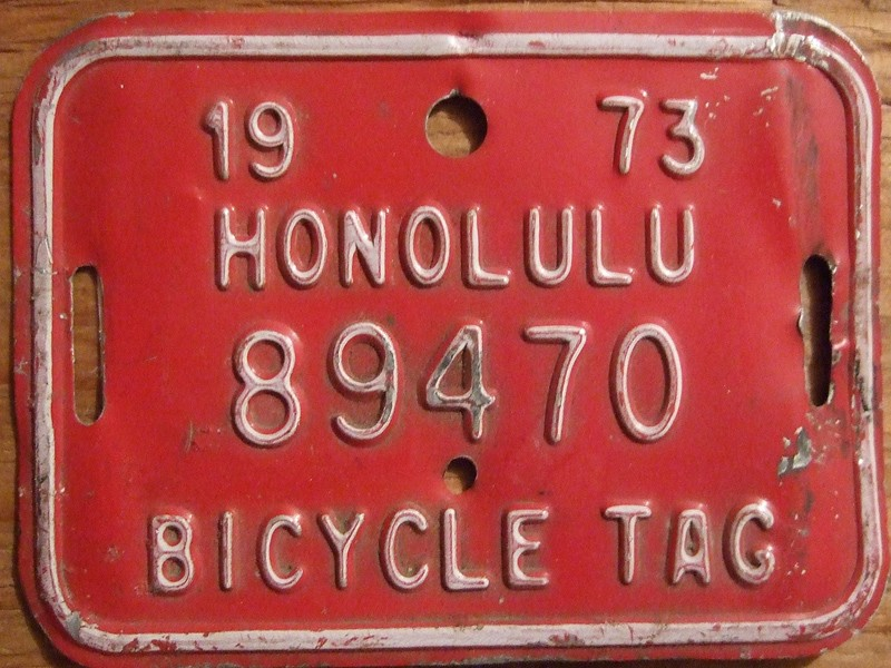 Could bicycle ID tags or number plates, like this vintage one from Hawaii, become compulsory in more areas?