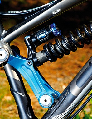 A forged aluminium linkage with oversized bearings now drives the shock