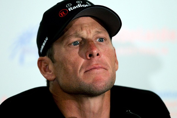 Lance Armstrong listens to a question at the Tour Down Under press conference